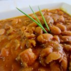 Easy 'Charro' Beans - This Mexican-style 'pork and beans' features pinto beans fried with bacon, ham, and chorizo, seasoned with smoky chipotle and garlic.