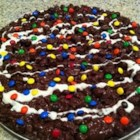 Rocky Road Candy - Chocolate chips are melted with a bit of unsweetened chocolate and butter and then combined with eggs, confectioners' sugar, peanuts and marshmallows and chilled for an easy candy.