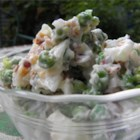 #1 Pea Salad Most Requested! - Green peas, smoke-flavored almonds, and onion are folded together with mayonnaise for a creamy and crowd-pleasing salad.