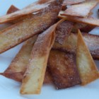 Fried Cinnamon Strips - Flour tortilla strips are deep-fried then coated with cinnamon and sugar for a quick, crunchy snack.