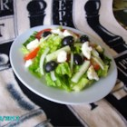 Greek Salad, The Best! - Cucumbers, tomatoes, red onions, olives, feta cheese, and romaine are tossed with a red wine vinaigrette in this Greek-inspired salad.