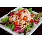Shrimp and White Bean Salad - Shrimp, white beans, red onion, and fresh tomatoes are tossed in an Italian vinaigrette and served over salad greens for a simple and tasty option for lunch or dinner.