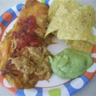 Pork Enchiladas - Leftover cooked pork gets a Mexican-style makeover when mixed with chilies and enchilada sauce, wrapped in tortillas, and topped with melted cheese.
