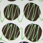 Peppermint Patties - Peppermint-flavored patties made of confectioners' sugar and condensed milk are air-dried, then dipped in semi-sweet chocolate to make these holiday candies.