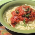 Seven Ingredient Tomato Sauce - This is a very simple recipe to make and tastes great too.  This sauce tastes extra good if you add fried meatballs or pork spareribs to the sauce.  Another good addition is a can of drained peas, if you like them.  Happy eating!