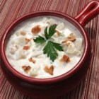 Clam Chowder II - New England clam chowder is embellished with canned clams,  half-and-half, and condensed cream of potato soup in this recipe for a crowd.
