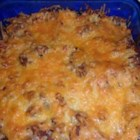 Texas Rice - Rice and ground beef in tomato sauce, baked under a layer of shredded cheese. A great way to feed a crowd! Leftovers can be made into quick roll-ups by microwaving in a tortilla.
