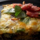 Italian Frittata - Salami, mushrooms, tomatoes, and artichoke hearts are baked in this cheesy egg dish perfect for brunch or a light lunch.