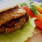 Thai Burgers - What a wonderful taste surprise. Ground beef is mixed with lemon grass, chili paste, shallots and peanuts, and then formed into thick patties, and grilled. Just before serving they 're sprinkled with fresh lime juice. Makes four generous servings.