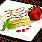 Napoleons - Golden puff pastry is layered with pastry cream and jam and then iced before being cut into bars.
