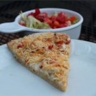 Gourmet Chicken Pizza - Pizza gets a little style with chopped tomatoes replacing sauce, and the addition of ranch dressing and shredded chicken