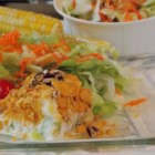 Hot Turkey Salad - One family's vintage 'after Thanksgiving' casserole, this hot turkey salad mixes leftover turkey with celery, grated onion, chopped pecans, mayonnaise, and lemon juice and bakes it under a topping of Cheddar cheese and crushed potato chips.