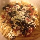 Greek Pasta - Linguine topped with a hot tomato mushroom sauce and sprinkled with crumbled feta and black olives.