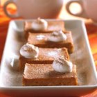 Pumpkin Pie Squares - An oaty brown sugar crust topped with spiced pumpkin, baked and cut into bars.