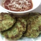 Zucchini Fritters - Crispy fried cakes of zucchini, yellow squash, and carrots make a delicious appetizer or side dish.
