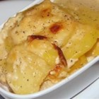 Garlic Potatoes Gratin - Red potatoes are layered with rich Gouda cheese and baked with butter and garlic.
