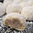 Mexican Wedding Cookies - Delicious nutty cookies that are rolled in powdered sugar. These are perfect for any special occasion.