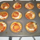 Cheesy Cheeseburger Pizzas - If you don't want to spend hours in the kitchen, try this recipe - you won't be disappointed! Refrigerated biscuits are flattened out into individual pizzas, and topped with ground beef, pepperoni, pizza sauce, feta and mozzarella cheese. Very kid-friendly and delicious.