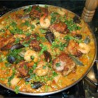 Easy Paella - In this version of the classic Spanish dish, chicken, chorizo sausage, and shrimp combine with rice simmered in broth and flavored with saffron threads, garlic, onions, red pepper flakes, paprika, and bay leaf.