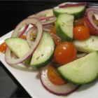 Italian Tomato Cucumber Salad - Fresh oregano and extra-virgin olive oil add an Italian-inspired dimension to the cucumber and tomato salad.