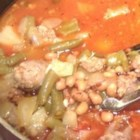 Black-Eyed Pea Bratwurst Stew - Hot wing sauce gives this sausage and black-eyed pea stew a spicy kick.