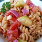 Veggie Pasta Salad - Fresh hot chile pepper gives a little heat to this pasta salad packed with sweet onion, bell pepper, tomatoes, and cucumber.