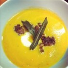 Butternut Squash Soup With Sage and Sausage - Creamy butternut squash soup with crisp pork sausage is topped with sour cream and fried sage leaves for a sweet and savory soup with a touch of gourmet flavor.