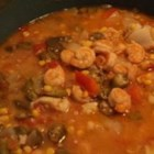 Shrimp Gumbo - A dark roux begins this recipe for thick shrimp gumbo featuring okra, onions, bell pepper and diced tomatoes.  Serve this stew over long-grain white rice.