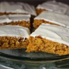 Paul's Pumpkin Bars - A homemade pumpkin sheet cake topped with cream cheese icing that will feed a crowd. Everybody loves them!