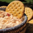 Mary's Roasted Red Pepper Dip - This is a HUGE hit at all of my parties!!!  With kids, as well as adults...and it is very easy to make!!! Serve this flavorful dip with tortilla chips. Roasted red peppers and two kinds of cheese create the perfect combination. Adjust the amounts of onion and garlic to taste.