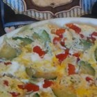 Zucchini Oven Frittata - A delicious, easy frittata recipe full of good vegetables and topped with cheeses.