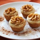 Dianne's Pumpkin Cookie Cups - These sugar cookie cups filled with a sweet and creamy pumpkin filling will be the cutest addition to your Halloween or Thanksgiving dessert table! Sprinkle with additional cinnamon or chopped nuts for decoration if desired.