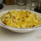 Cheesy Amish Breakfast Casserole - This hearty casserole has bacon, eggs, hash browns, and three different cheeses all baked into a comforting breakfast dish, perfect for feeding a crowd.