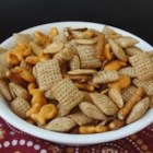 Halloween Party Mix - A new twist on party snack mix includes pumpkin seeds, goldfish crackers, and pretzel sticks for a Halloween-inspired treat.