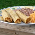 Easy Chicken Taquitos - Corn tortillas are tightly rolled around a cheesy chicken mixture and baked until crisp. Serve these baked taquitos as an appetizer with salsa or top with lettuce, tomato, and sour cream for a main course.