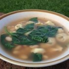 Pasta Fazoolander - This hearty winter soup features cheese tortellini, white beans, and spinach in a rich broth.