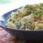 Potato and Mustard Greens Salad - Spicy mustard greens, chile sauce, and cornichons liven up this potato salad.