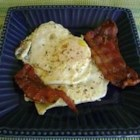 Heart Attack Eggs - This is a great breakfast, especially on the weekend.  You fry bacon on a skillet, then after the bacon is crispy, fry eggs in the bacon grease. Garnish your plate with toast or fruit.