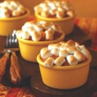 Whipped Sweet Potato Casserole - Sweet potatoes made sweeter with orange juice, brown sugar and nutmeg.  Topped with marshmallows and baked.