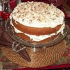 Cream of Coconut Cake - Cream of coconut and sour cream help this cake recipe deliver a wonderfully moist coconut cake with a cream cheese icing.
