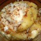 Brazilian Bananas - Bananas are baked in a citrus sauce then topped with coconut before serving in this tropical treat.