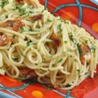 Spaghetti with Bacon - Spaghetti and bacon is simply flavored with garlic and Italian parsley in this quick and easy pasta dish.