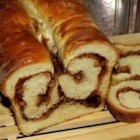 Cinnamon Swirl Bread for the Bread Machine - Use the dough cycle of your bread machine to make two delicious loaves of cinnamon-walnut bread. Once the dough is ready, it's simple to form the spiral loaves and bake them in the oven. Your house will smell like heaven.