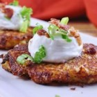 Loaded Mashed Potato Cakes - Cheesy, pan-fried patties of mashed potatoes are sure to be the star of your next meal.