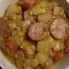 Sausage Potato Bake - Slices of smoky kielbasa take on hearty chunks of potatoes in a tasty blend of cream of mushroom soup and vegetable beef soup. Bake this substantial casserole in the oven, or fire up that slow cooker for a people-pleasing, cold weather meal.