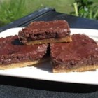 Chocolate Chip Dream Bars - Yummy chocolate chip cookie bars with a delightful chocolate glaze.