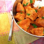 Curry Stand Chicken Tikka Masala Sauce - Chunks of chicken simmer in a spicy tomato and cream sauce for the bright orange chicken tikka masala you crave.