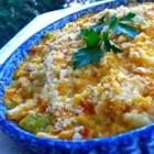Katy's Scalloped Corn -  Onion, green pepper and celery are sauteed until tender and then combined with niblet and cream-style corn and cheddar cheese. Half way through the baking, crumbled buttery crackers are sprinkled on top. Perfect dish to take to a party, keeps well.
