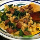 Orcchiette Pasta with Broccoli Rabe and Sausage - Bitter broccoli rabe and hot Italian sausage are the main flavors in this ear-shaped pasta.