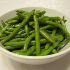 Easy Garlic Green Beans - All you need is butter, garlic, and salt to make this delicious and easy side dish. Double or triple the recipe for a quick way to serve a crowd.